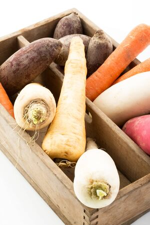 parsnips: Wooden box with parsley root, beetroot, parsnips, white and red radish