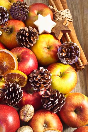 christmas scent: Christmas plate, apples, cinnamon stars, fir cones and cinnamon sticks Stock Photo