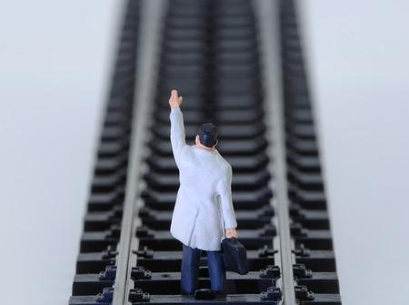 male likeness: Business man figurine waving Stock Photo