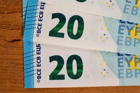 euro notes: Banknotes on wood, twenty Euro notes Stock Photo