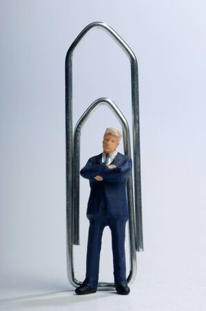 Paper clip and Business man figurines