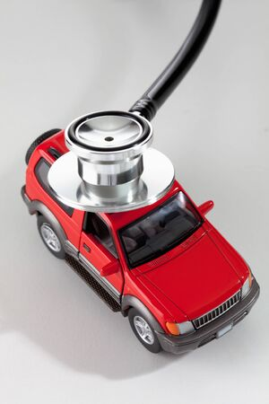 health care fees: Stethoscope on top of model car