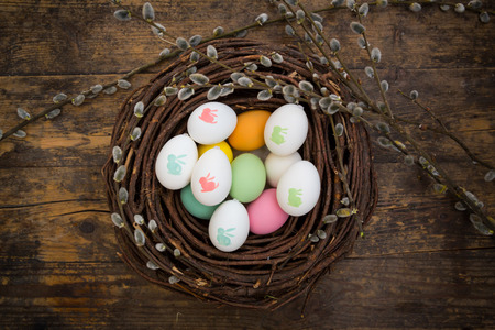 colored dye: Easter decoration, Easter eggs, twigs on wood