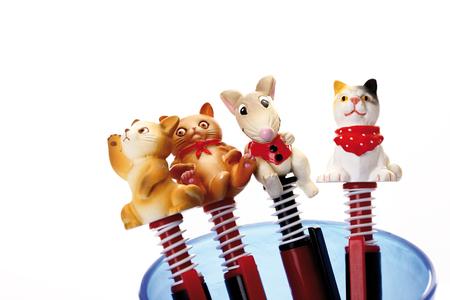 kitsch: Figurine pens, close-up