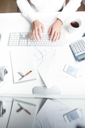 Woman working at desk, keyboard