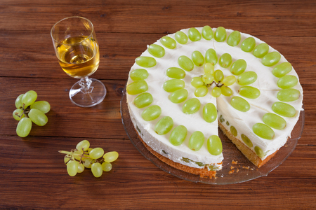 torte: Grape torte with green grapes on cake plate, white wine glass