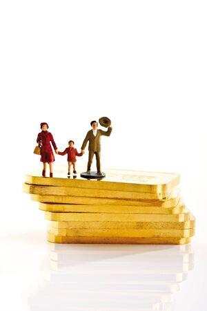 male likeness: Plastic figurines standing on gold bars