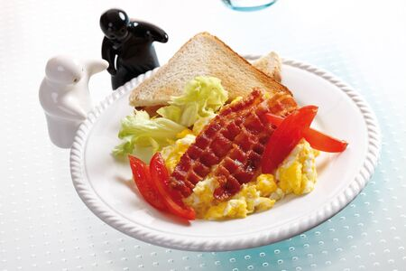 scrambled eggs: Scrambled eggs with ham on plate, elevated view Stock Photo