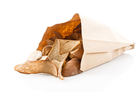 stale: Stale bread in paper bag on white background Stock Photo