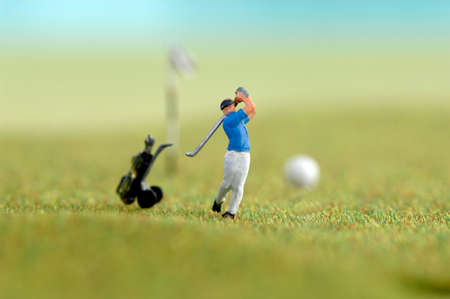male likeness: Plastic figurine playing golf Stock Photo