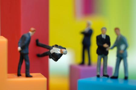 male likeness: Businessman figurines on bright building bricks, close up Stock Photo