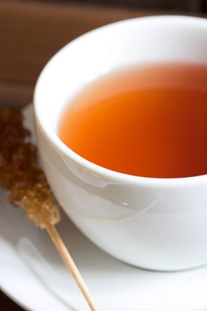 sweeten: Apple tea with rock candy in white cup