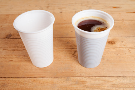 plastic cup: Empty plastic cup and coffee cup Stock Photo