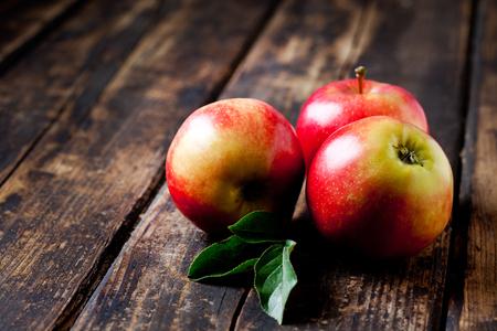 three leaf: Red apples on wood, Gala