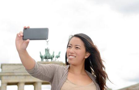 brandenburg gate: Germany, young woman with smartphone in Berlin, selfie, Brandenburg Gate