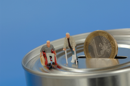male likeness: Plastic figurines, in wheelchair and with crutches on money box