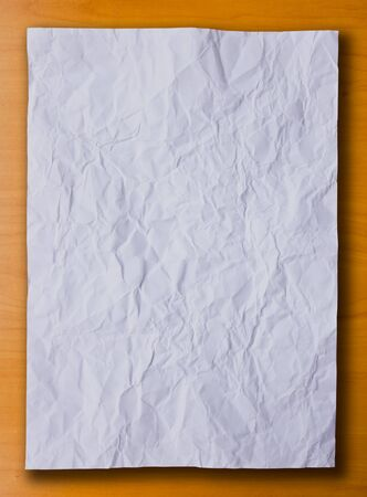 White crumpled paper on the wood background