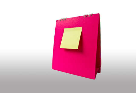 yellow note on pink calendar photo