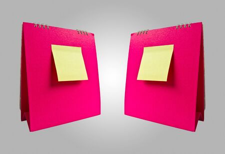 yellow note on double pink calendar Stock Photo - 8042812