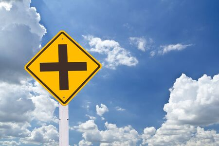 intersection warning sign in blue sky Stock Photo - 8248170
