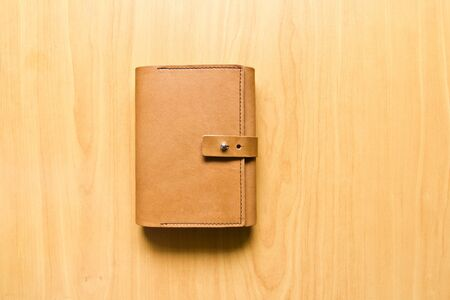 leather case notebook on wood background photo
