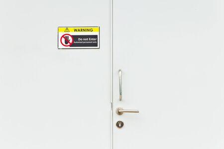 no entry warning sign on lock door photo