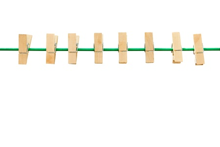 wooden clothespin and green rope isolated photo