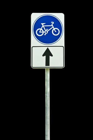 bicycle way sign isolated on black background photo