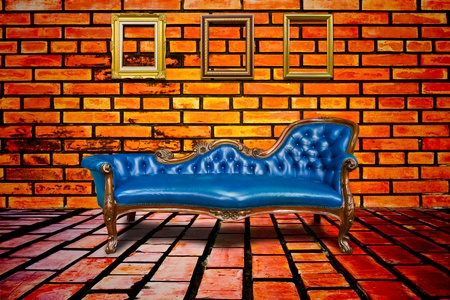 luxury blue armchair and wooden frame on brick wall photo