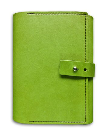 green leather case notebook isolated on white background photo