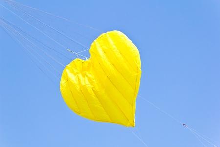 love heart kite against blue sky photo