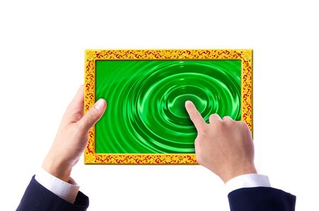 hand of business man holding and touching on sclupture touch pad photo