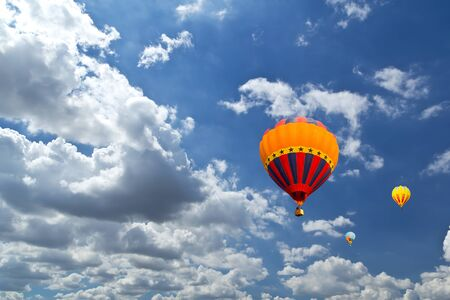 Colorful hot air balloons against blue sky Stock Photo - 9055621