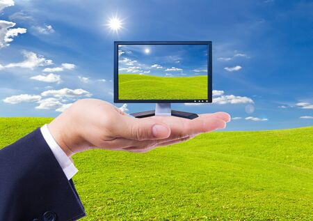 LCD Monitor in hand isolated photo