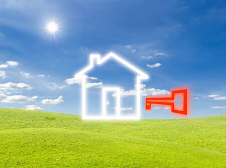 key of house icon on green grass meadow photo