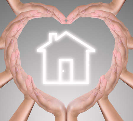 house icon in heart hand photo