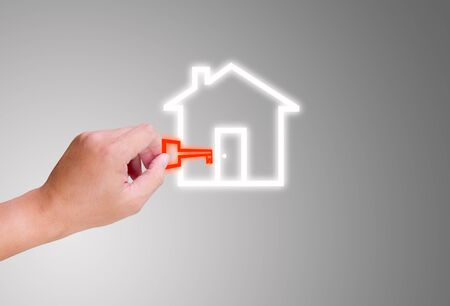 hand holding key for house icon photo