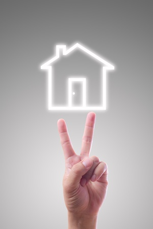 hand pointing to house icon photo