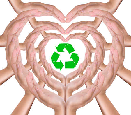 environmental safety: recycle sign in hand heart Stock Photo