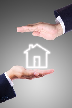 business man hand giving house icon photo