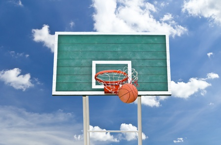 backboard: basketball hoop against blue sky Stock Photo
