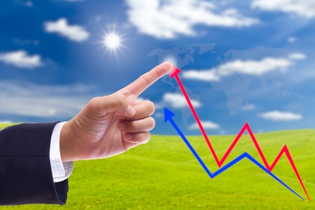business man hand bring up the graph in blue sky photo