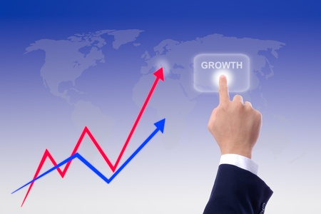 hand pushing growth button and graph photo