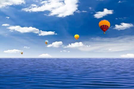 colorful hot air balloon on the sea photo