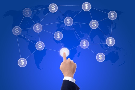 business man hand pressing button of money network photo