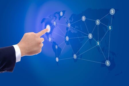 global strategy: business man hand pushing button of dollar sign network Stock Photo