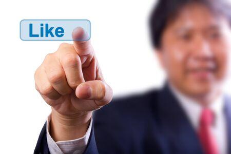 business man pushing  like button photo