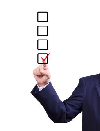 zakenman kant kiezen vinkje op doos Stockfoto