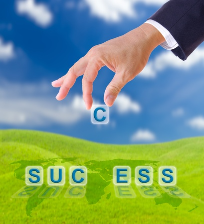 hand puting letter c to  success word on blue sky , business concept photo