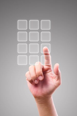 dialing: hand pushing transparent telephone buttons Stock Photo